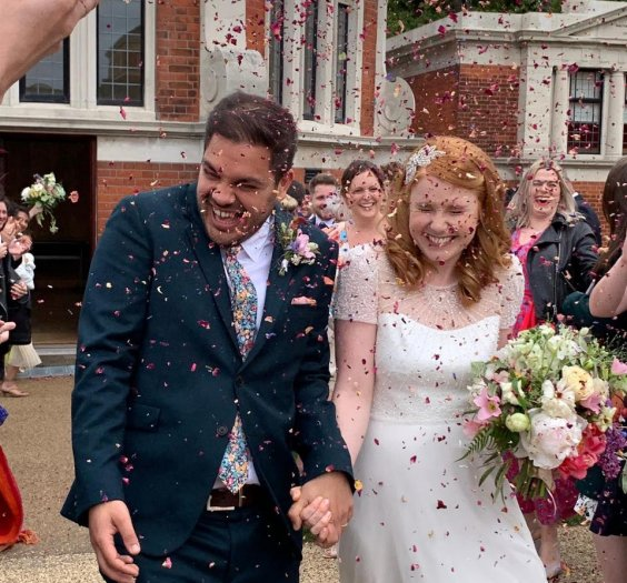 Hayley and Graham get a congratulatory shower of confetti!